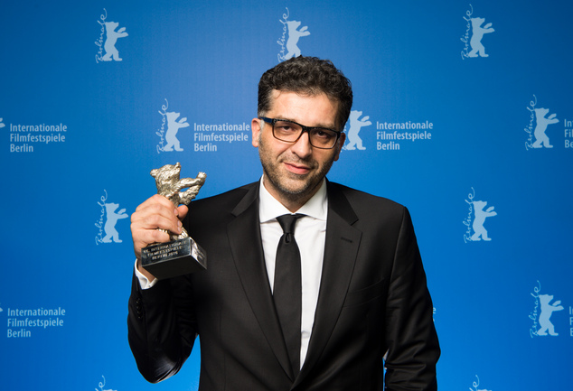 Danis Tanovic, the director of ''Smrt u Sarajevu') shows off a Silver Bear he was awarded as Grand Jury Prize during the award ceremony of the 2016 Berlin Film Festival Berlinale on Saturday, Feb. 20, 2016 in Berlin. (Bernd von Jutrczenka/pool photo via AP)