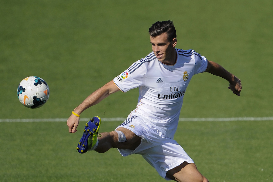 Real Madrid's Welsh forward Gareth Bale takes part in a training session at the Valdebebas training ground in Madrid on September 13, 2013.   AFP PHOTO / PEDRO ARMESTRE