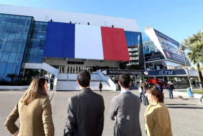 A giant French flag set up on the Cannes festival palace in Cannes , southeastern France Friday, Nov. 27, 2015. French President Francois Hollande called on his compatriots to hang French tricolor flags on Friday to pay homage to the victims of the Nov. 13, attacks, an unusual appeal by a Socialist leader in a country where flag-waving is often associated with nationalists and the far right. (AP Photo)