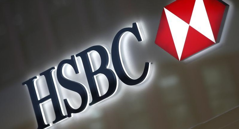 A HSBC logo is seen above the entrance to a HSBC bank branch in New York City